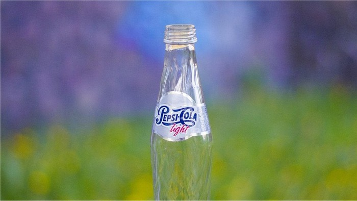 An empty bottle of Pepsi.