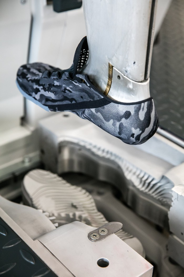 A piece of machinery making an Under Armour shoe.