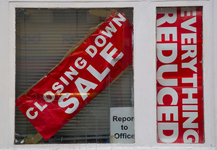 A store window with going-out-of business signs
