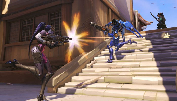 Screenshot of Overwatch gameplay with two in-game characters shooting at each other.