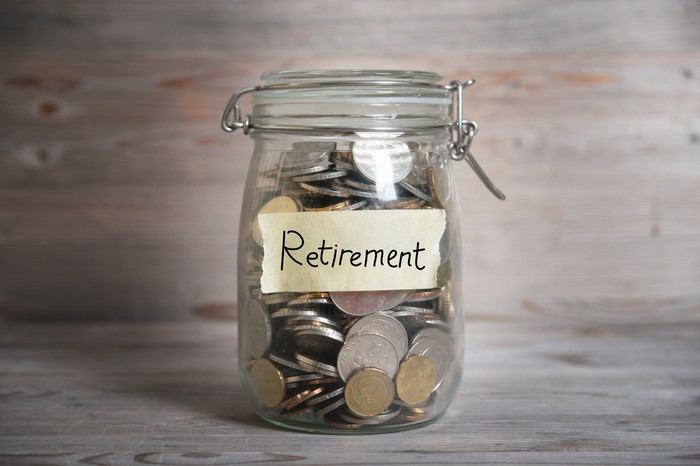 "jar of money, labeled ""retirement"""