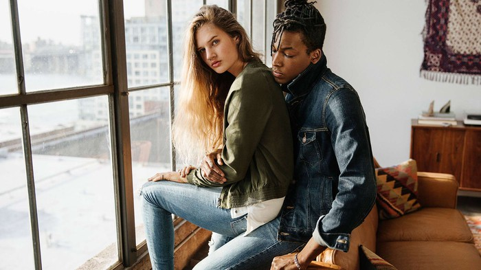 Two models wearing American Eagle Outfitters apparel.