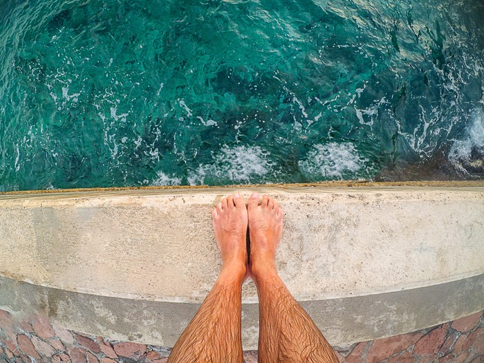 Feet at the edge of a cliff.