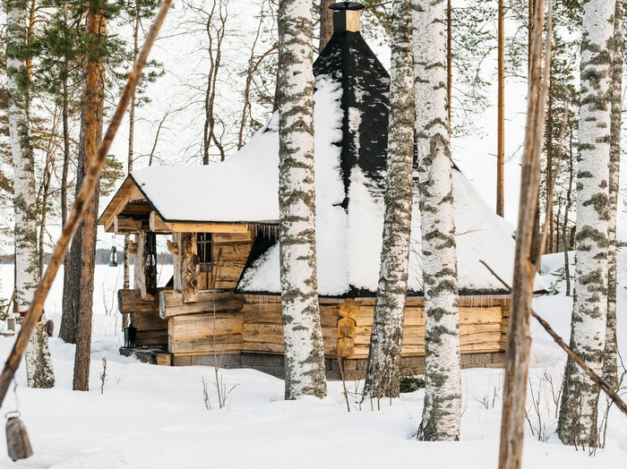 A snow-covered cabin in the woods
