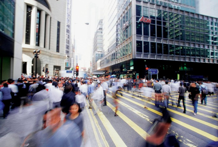 A busy intersection full of pedestrians in Hong Kong.