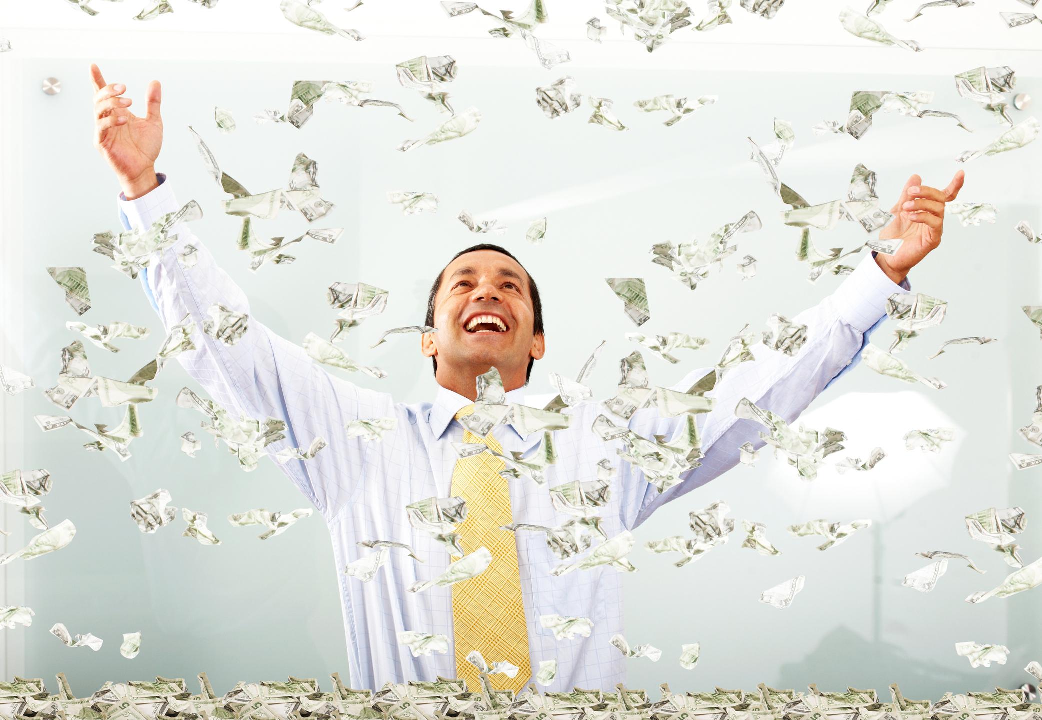 A man being showered in cash.
