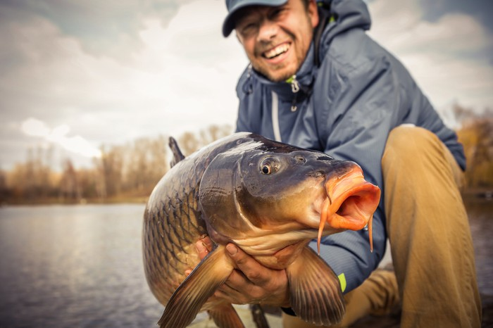 Fisherman holding a just-caught carp