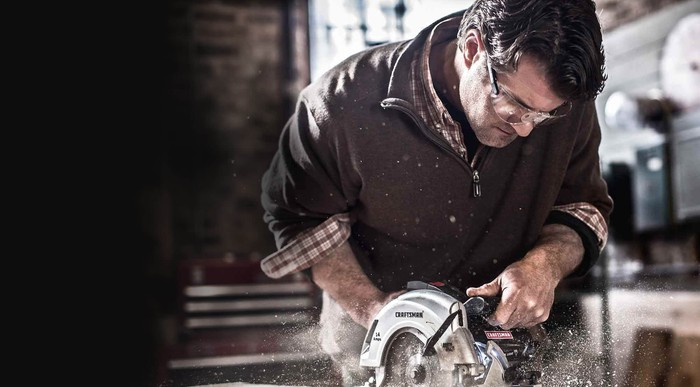 Man cutting wood with a Craftsman saw
