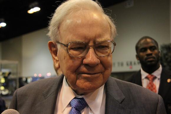 Warren Buffett explains to reporters his latest sells.