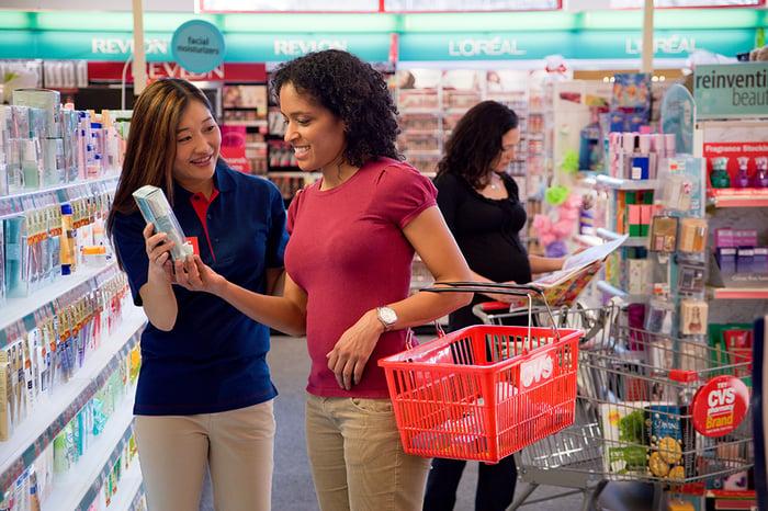 Female CVS Pharmacy front store employee with female customer.