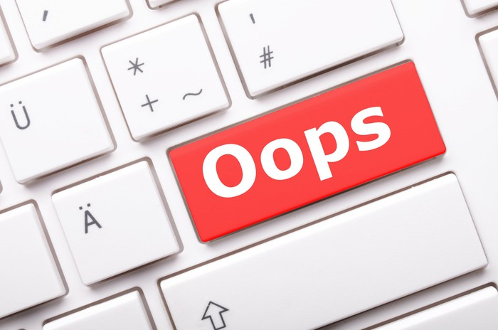 """A keyboard key in red, labeled """"oops"""""""