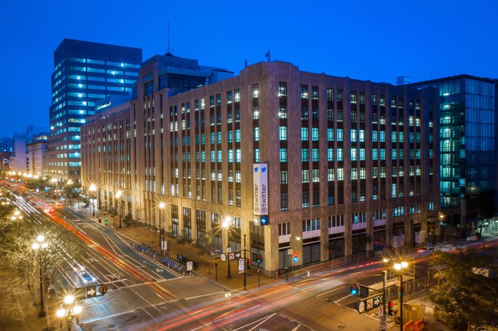 An exterior nighttime view of Twitter's headquarters in San Francisco.