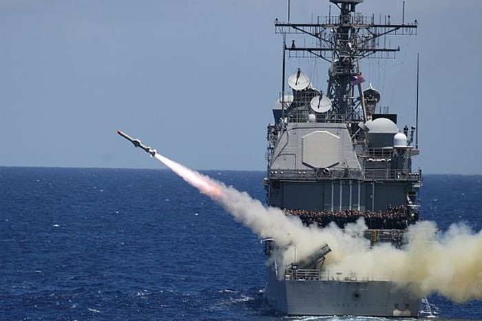 Harpoon missile launches from a ship at sea.