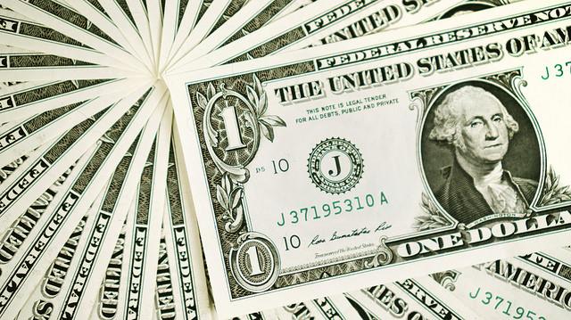 dollar bills making the shape of a fan.