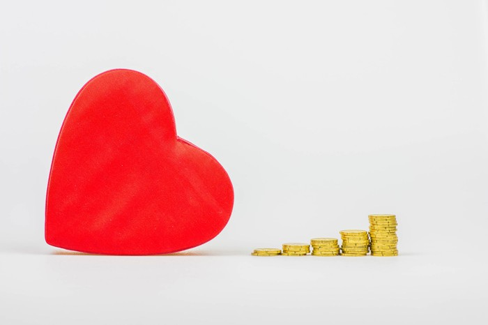 A heart next to coins.
