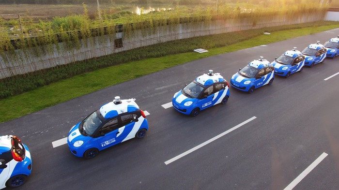 A fleet of self-driving cars topped with sensors.