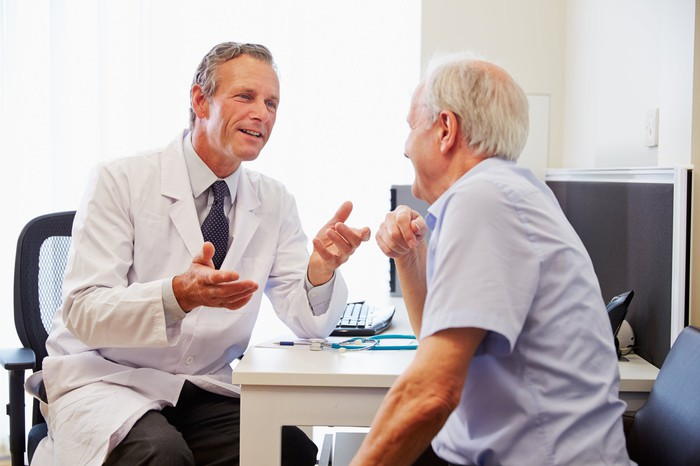 Male patient talking with doctor.