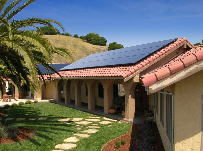 A rooftop solar system in the daylight.