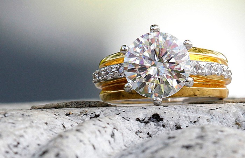 Diamond ring sitting on a granite counter.
