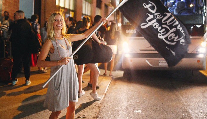 A woman waving a WeWork flag