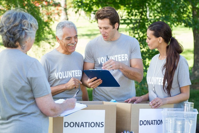 Group of volunteers collecting donated goods for a charity.