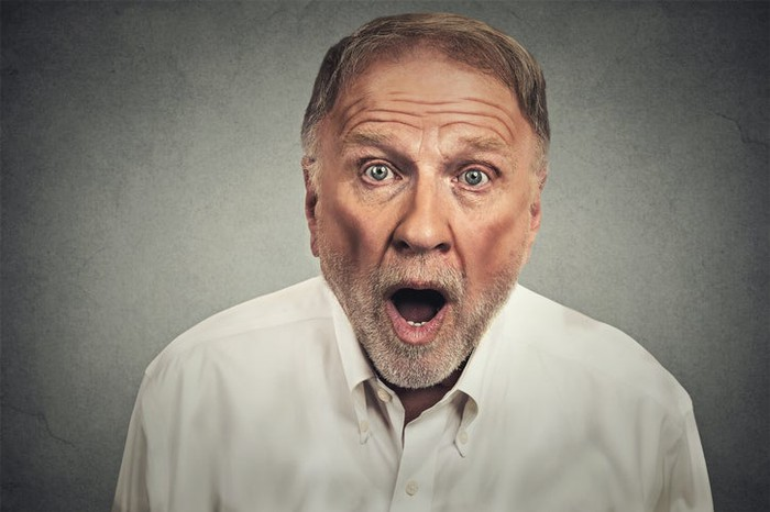 An older man with a surprised look on his face.
