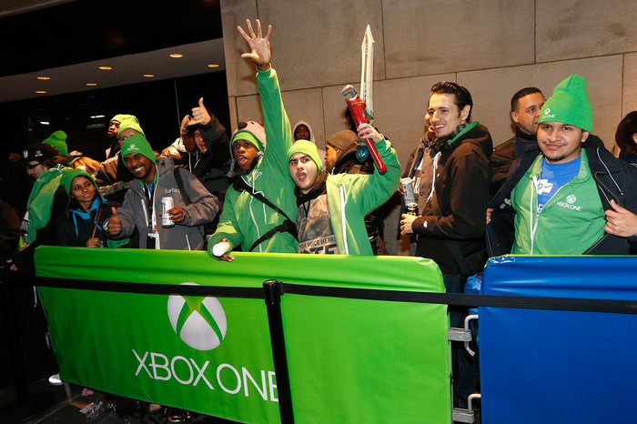 People celebrating the Xbox One launch