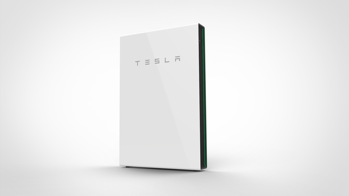Tesla Powerwall battery pack on a white wall.