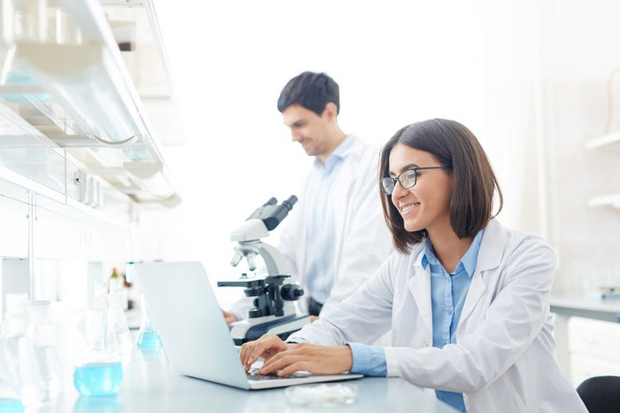 Two scientists working in their lab.