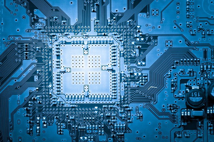 Microchip on a blue circuit board.