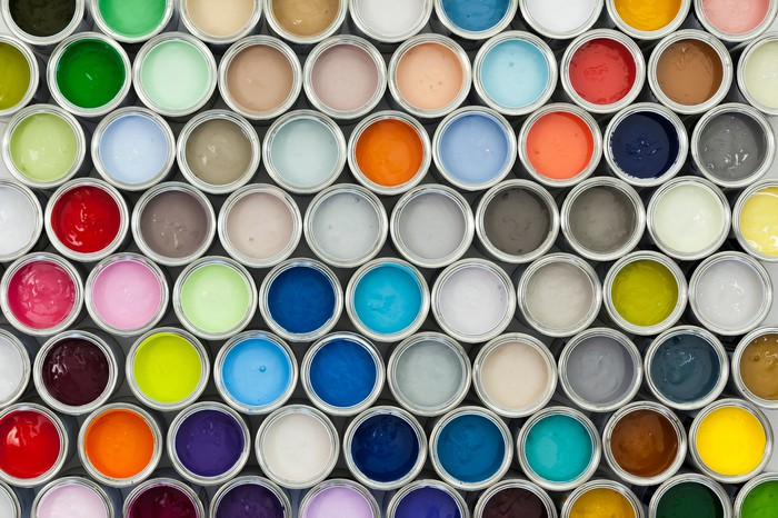 A selection of open paint cans viewed from directly above.