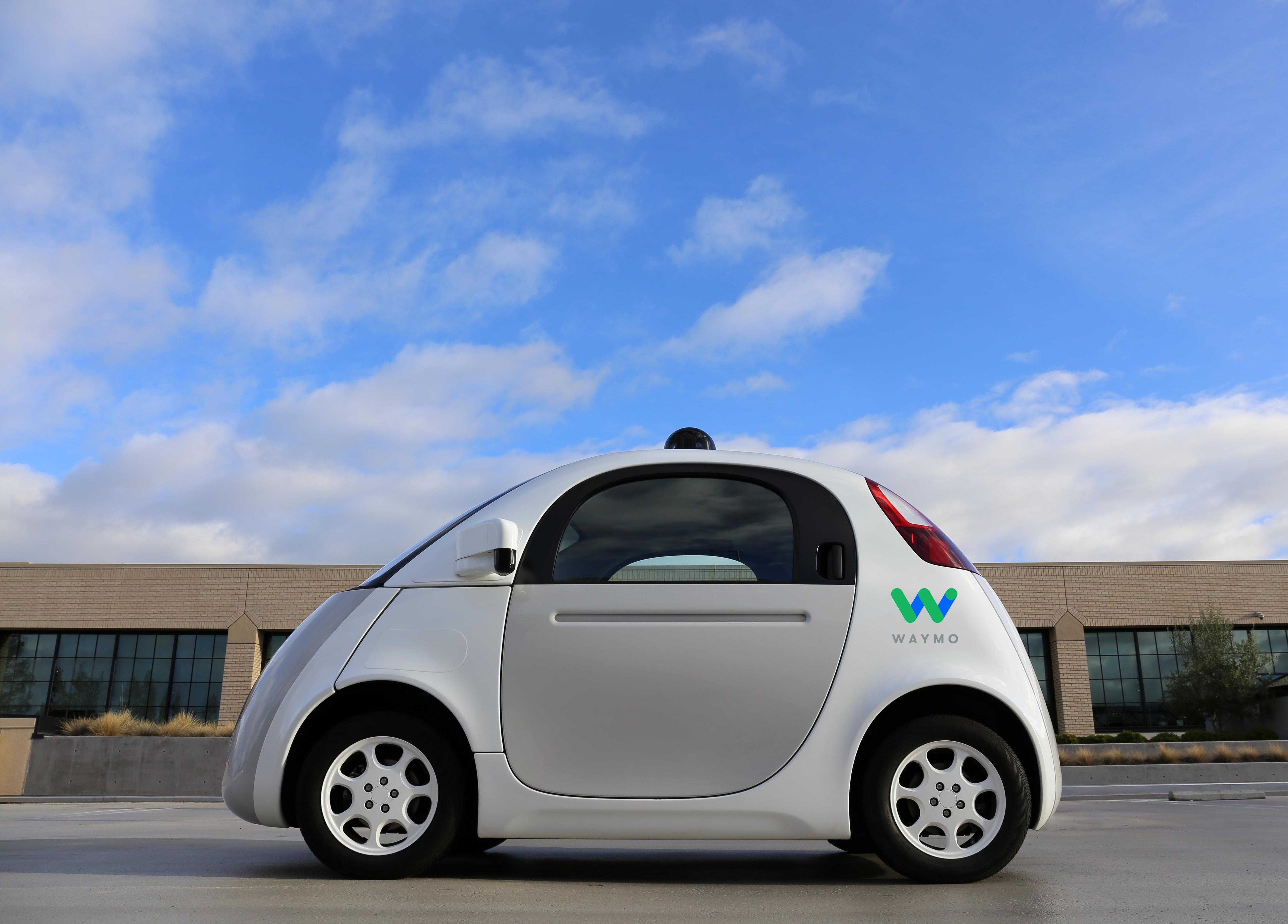 """A """"panda"""" test car with a Waymo logo."""