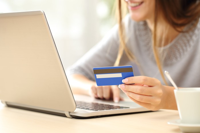 A lady shopping online using a credit card.