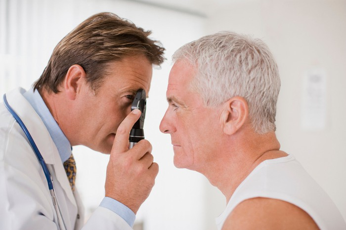 A doctor examines a patient's eye.