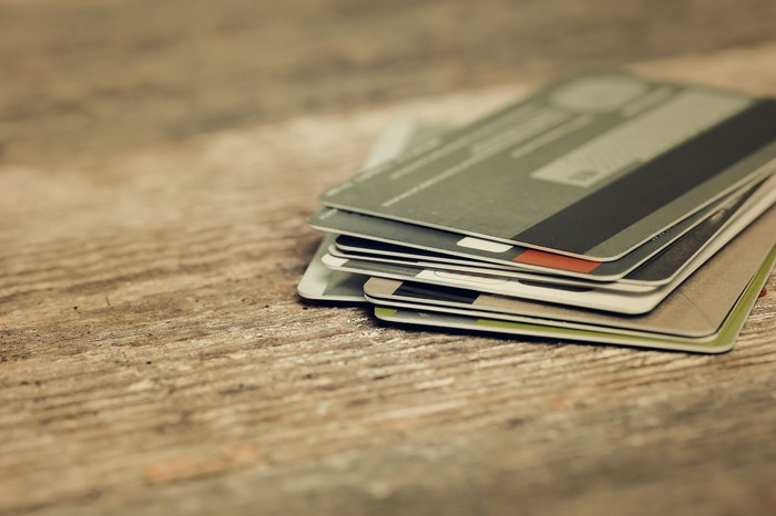 Multiple credit cards stacked on a table.