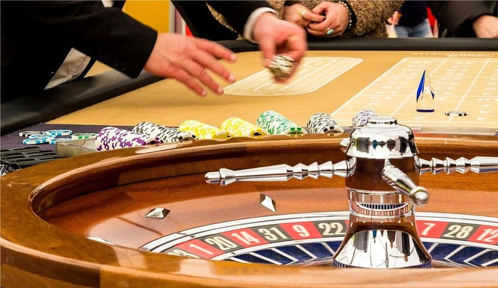 Gamblers play roulette.