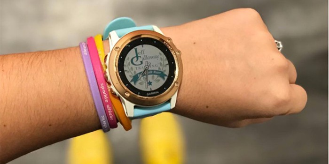 A wrist sporting a Garmin fitness tracker.