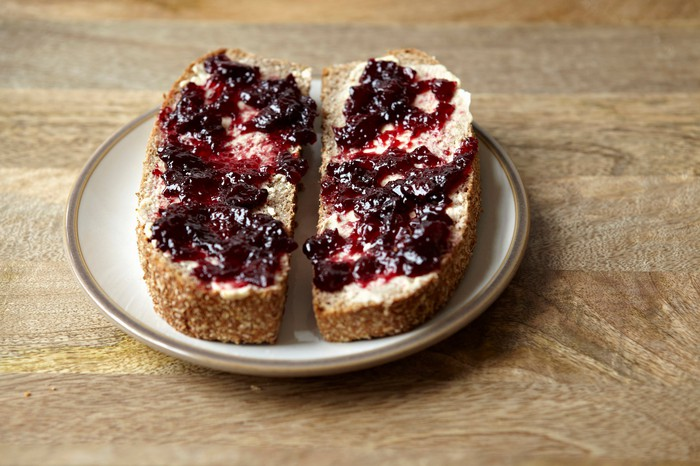 Blueberry jam spread on bread