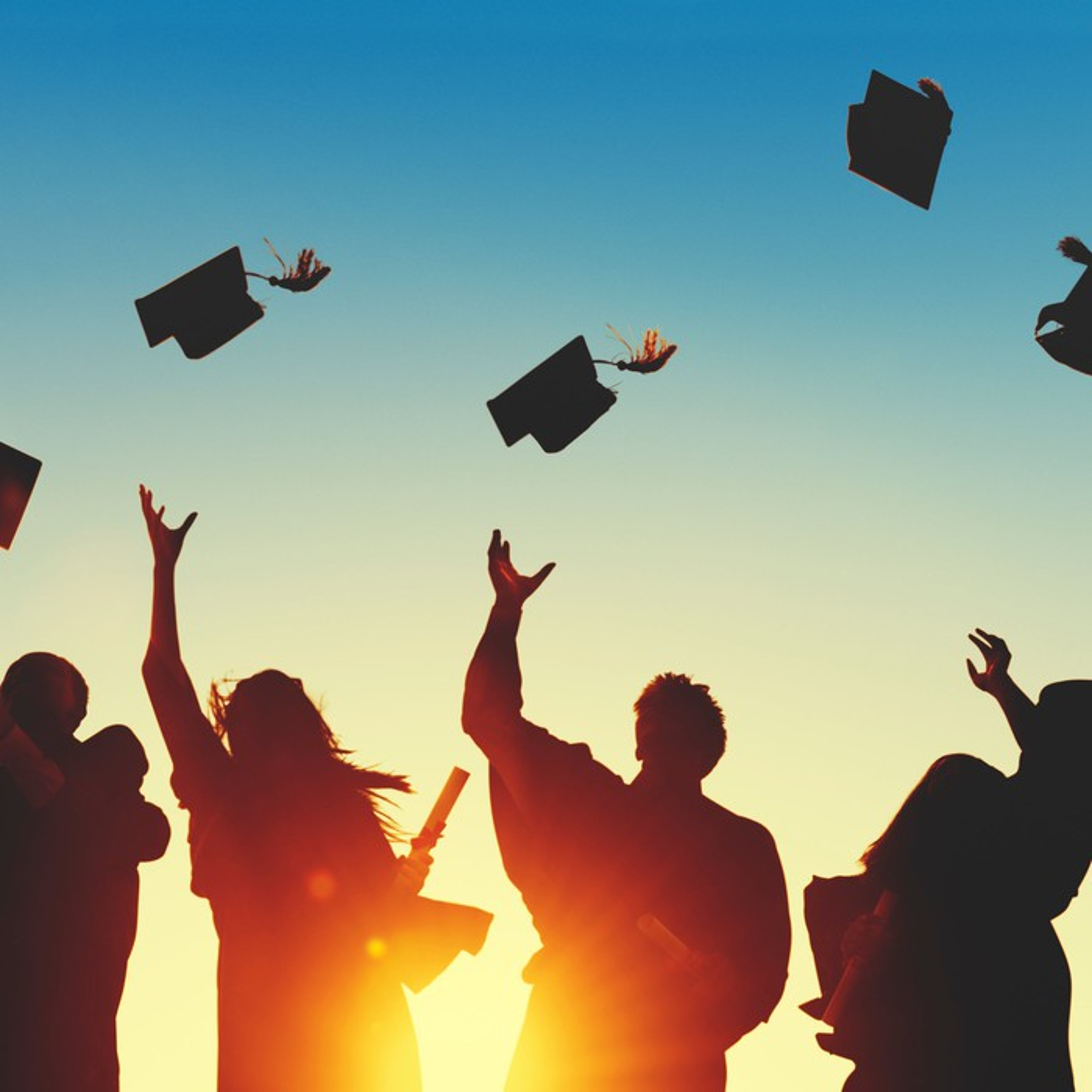 Graduates throw their hats in the air