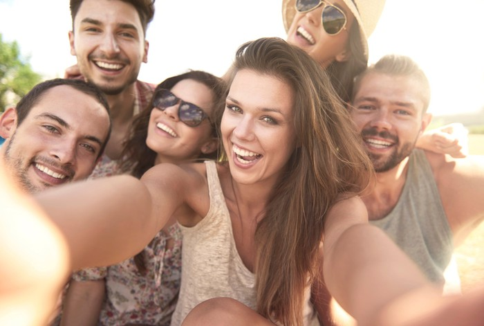 Group of people taking a selfie.