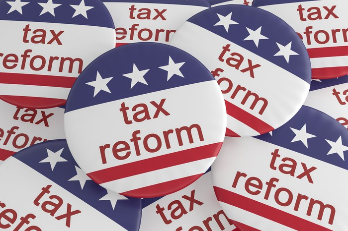 """Buttons with """"tax reform"""" and political design."""
