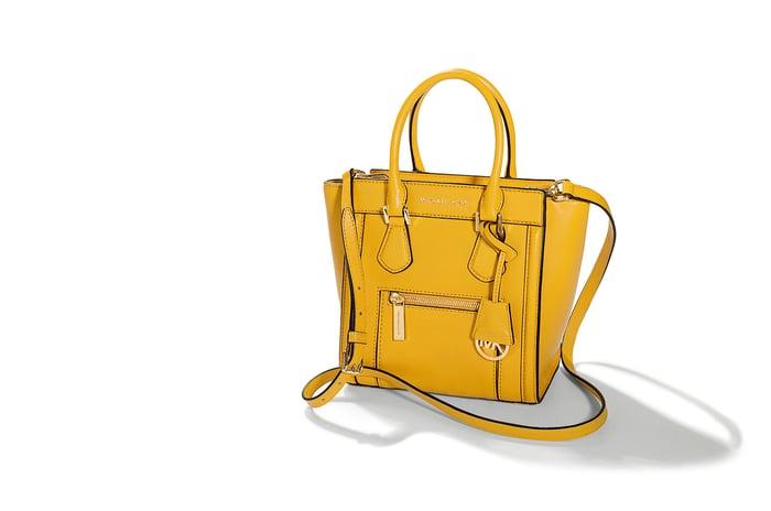 A yellow Michael Kors hand bag.