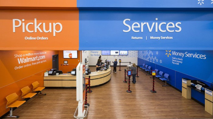 Inside a Wal-Mart store, the services area is displayed. On the left is where you pick up online orders. On the right is the returns and money services area.