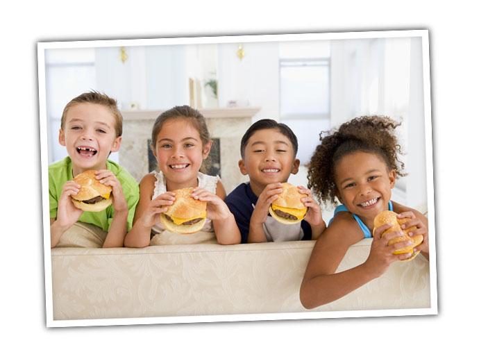 Kids eating cheeseburgers.