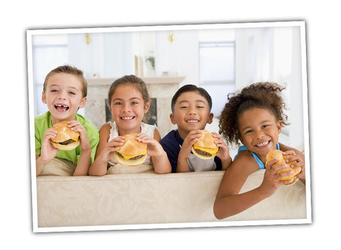 Kids eating cheeseburgers.
