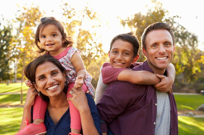 Young parents with two children.