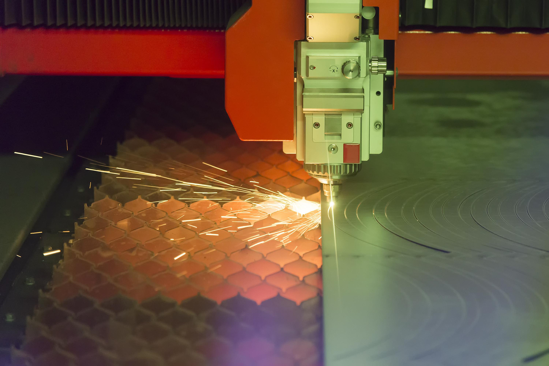 Fiber laser cutting machine in action.