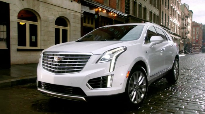 A Cadillac SUV on the street