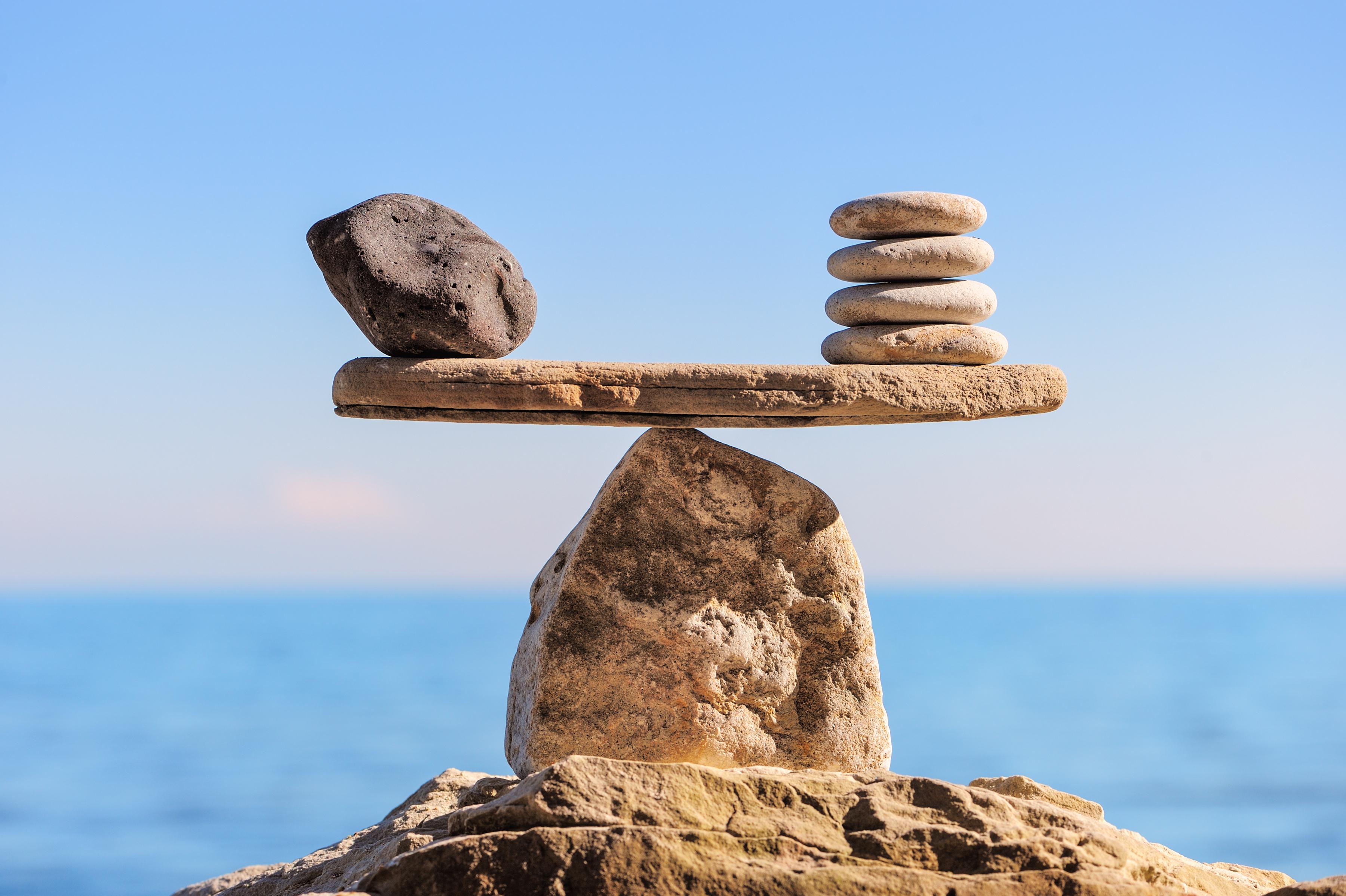 Rocks balanced on a beam.
