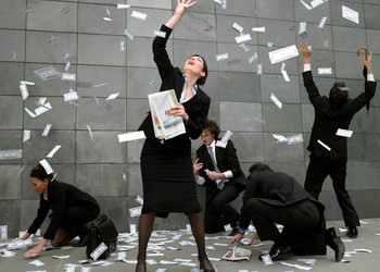 Businesspeople collect falling money